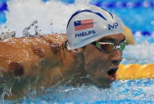 Michael Phelps (USA) of USA is seen with red cupping marks on his shoulder as he competes. REUTERS/Dominic Ebenbichler